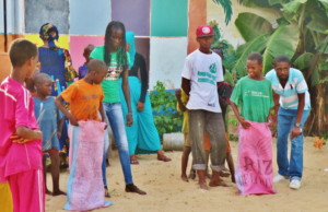 Volunteers organizing games with the children