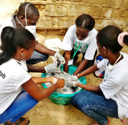 Volunteers washing laundry for talibe children