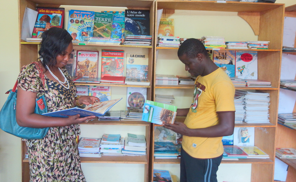 Teacher Bouri and librarian Bachir study new books