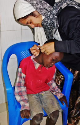 Mame Diarra tending to an infected ear