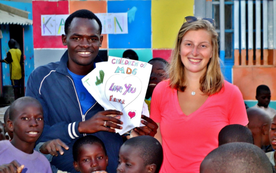 Abdou gives Kaylin cards MDG children made for her