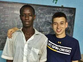 With Abou, who walked 2 hours each day to class