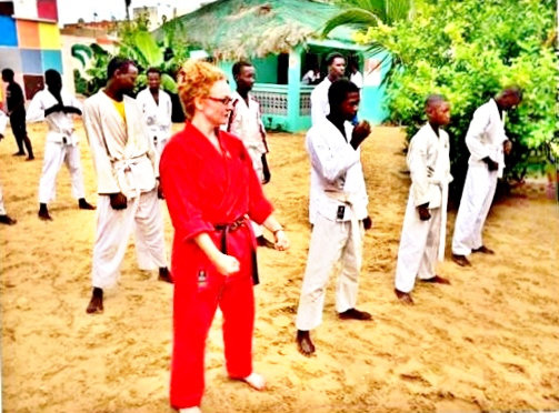Sonia, now a brown belt, leading class in the heat