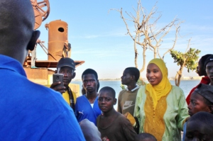 Teacher Bouri and the children listen attentively