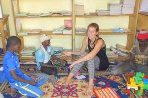 With children in Maison de la Gare's library