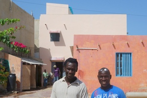 """Issa with Mamadou, in front of MDG's new """"jewel"""""""