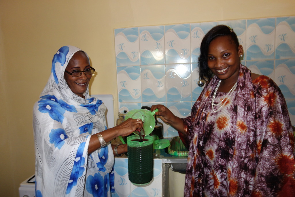 Teachers Aida, Bouri prepare juice in new kitchen