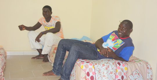 Talibes Ablaye and Mamadou hang out in new shelter