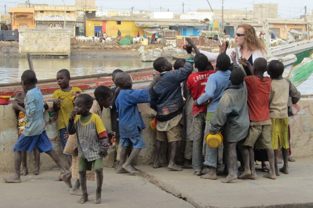 Sonia with begging talibe children in Saint Louis