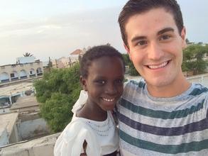 With host sister Adja Ngosse overlooking St. Louis