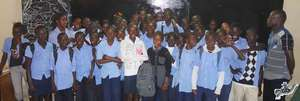 Arouna surrounded by his high school classmates
