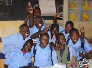 Arouna with his school friends in his classroom
