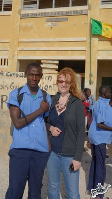 Arouna in front of his school with Sonia LeRoy