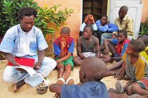 Issa reading to talibe children by MDG library