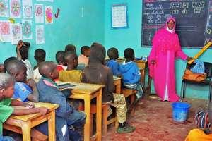 Teacher Aida introduces street children to French