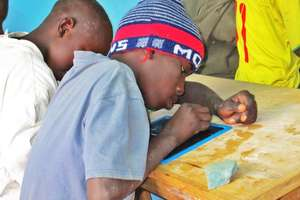 A talibe child intensely committed to learning