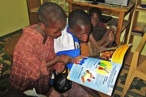 Street children discover a book for the first time