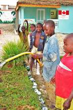 Children committed to the center's garden oasis