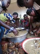 Community women prepare a feast for the children
