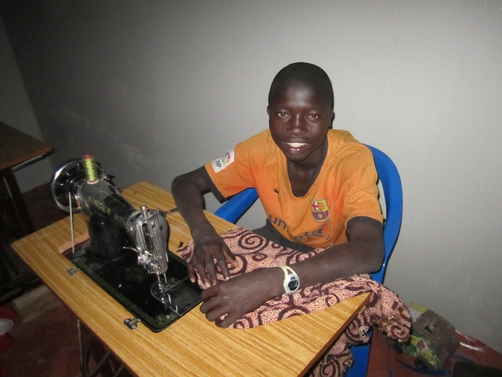 Kalidou learns tailoring at MDG center - Dec. 2011