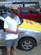 Dan with the Skoda, inscribed with MDG's logo