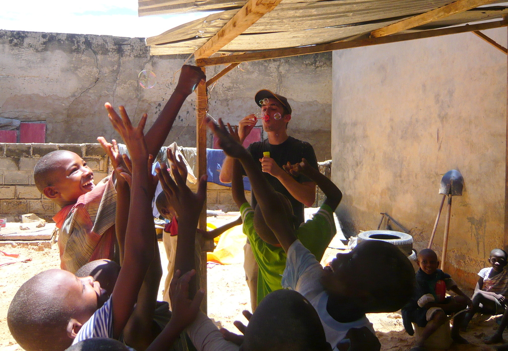 Jerome playing with children in their daara