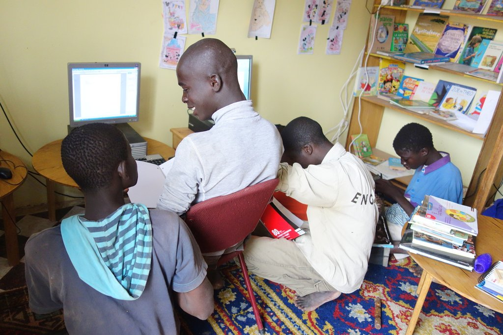 Talibe children writing and typing their messages