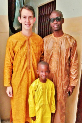 With host family members Maniang and Babacar
