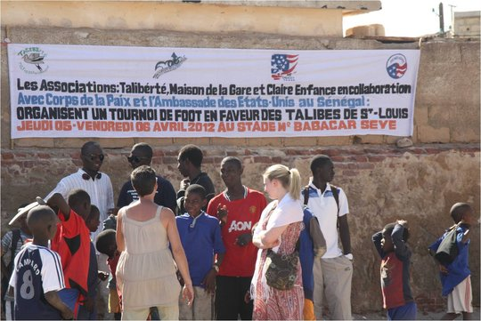Large banner announcing the soccer tournament