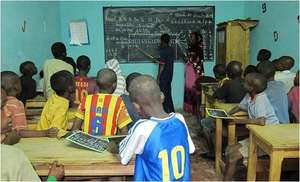 MDG teacher Aida with her class of talibe children