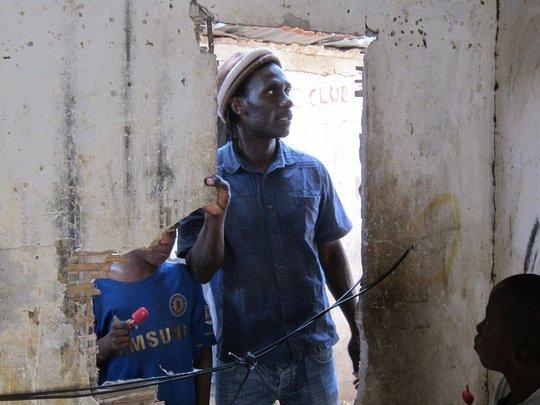 MDG founder Issa Kouyate entering a daara