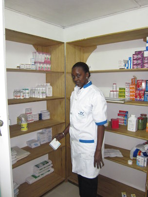 Nurse Anta in dispensary of MDG's infirmary