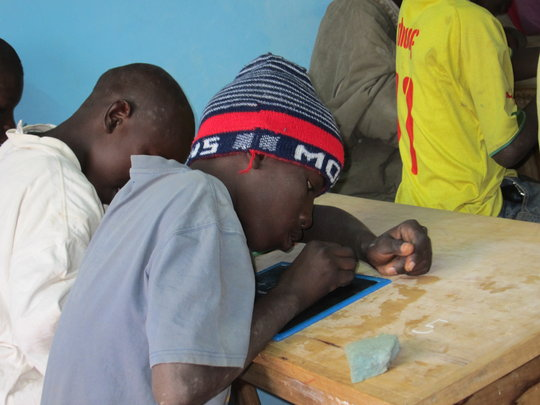 Talibe student concentrating in MDG classroom