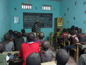 Teacher Aida Dieng with talibe students