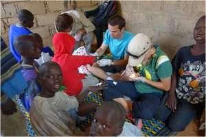 Tommaso providing health care in a daara