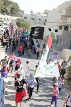 Freedom Bus creative march in Al-Walajah