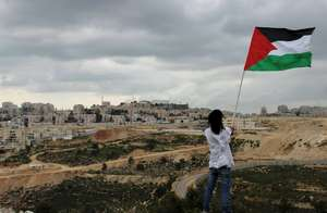Freedom Rider waving a flag close to a settlement