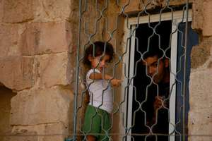 Girl watching Freedom Bus performance in Nablus