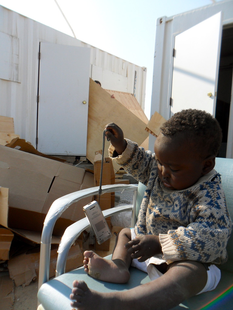 a DRC resident helping to unpack our clinic
