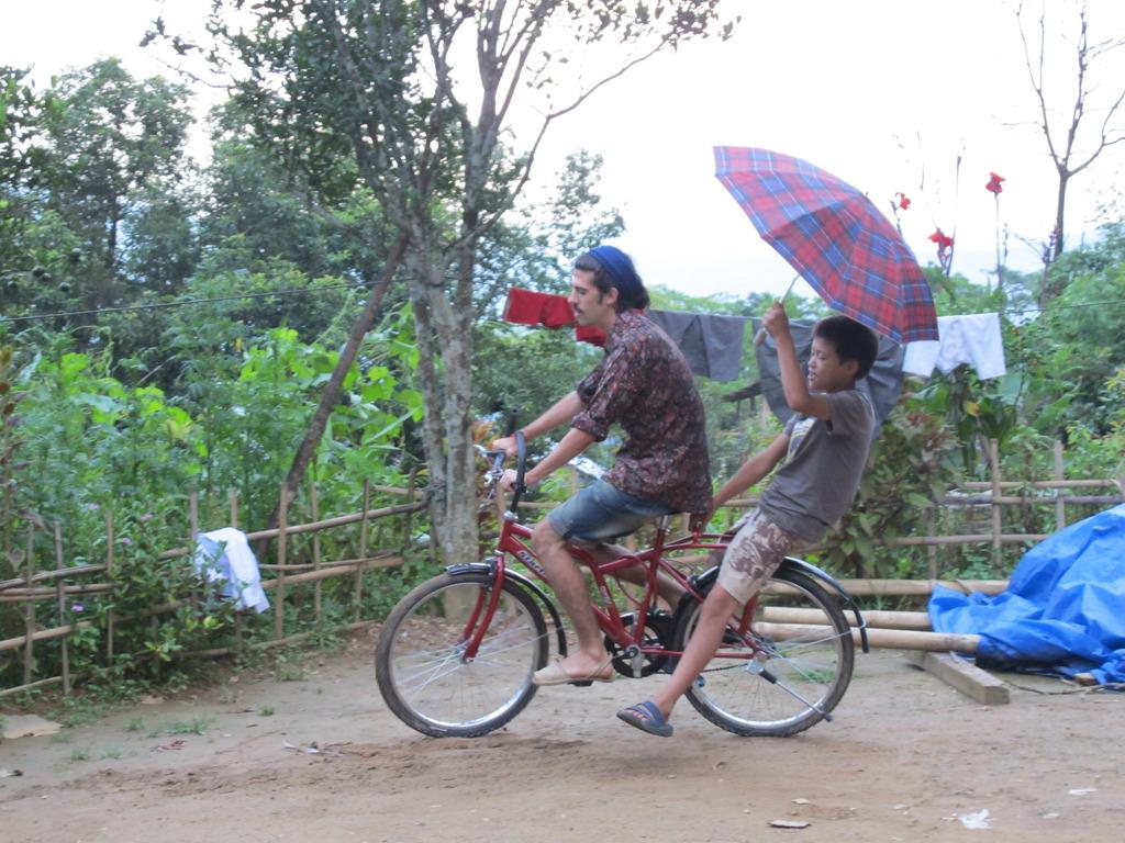 Rafael    teaching the kids to ride a bike