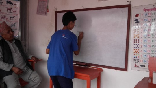 A deaf and mute kid  learning to write.