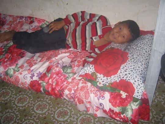 a boy Sundar is sleeping  in his bed