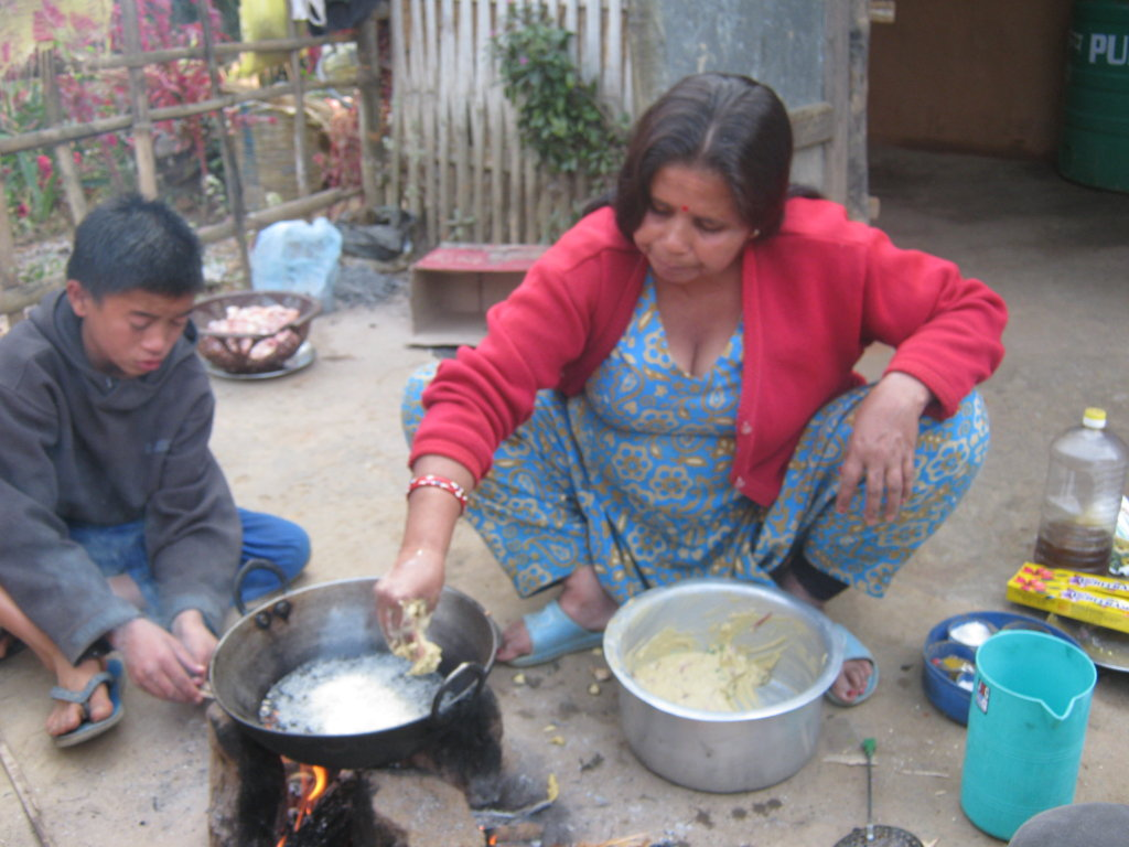 Care taker mother preparing food for  the kids