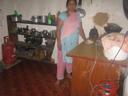 Caretaker  mother in  the kitchen