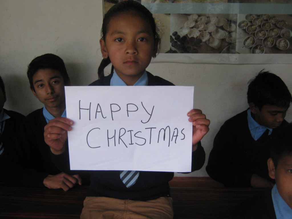 Kids expressing best wishes on   Christmas