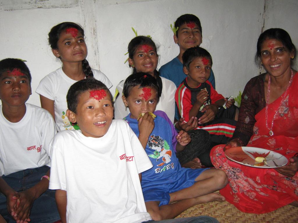 Kids receiving   Tika an d Jamara