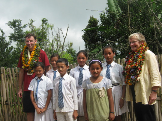 Michaela and  his mother with sponsored kids