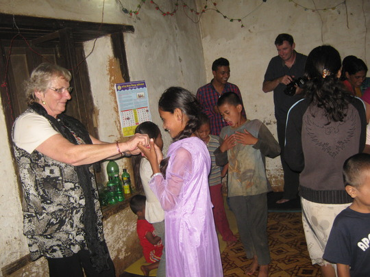 Michael's mother dancing with the kids