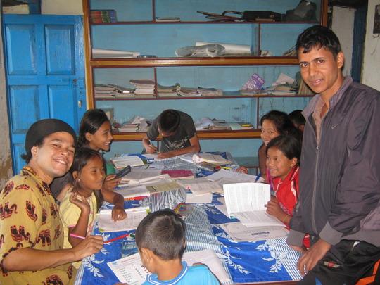 Jumoke  the  volunteer and the tutor with kids