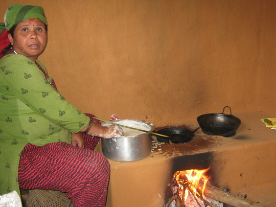 Cook Mother cooking Sel Roti for the kids